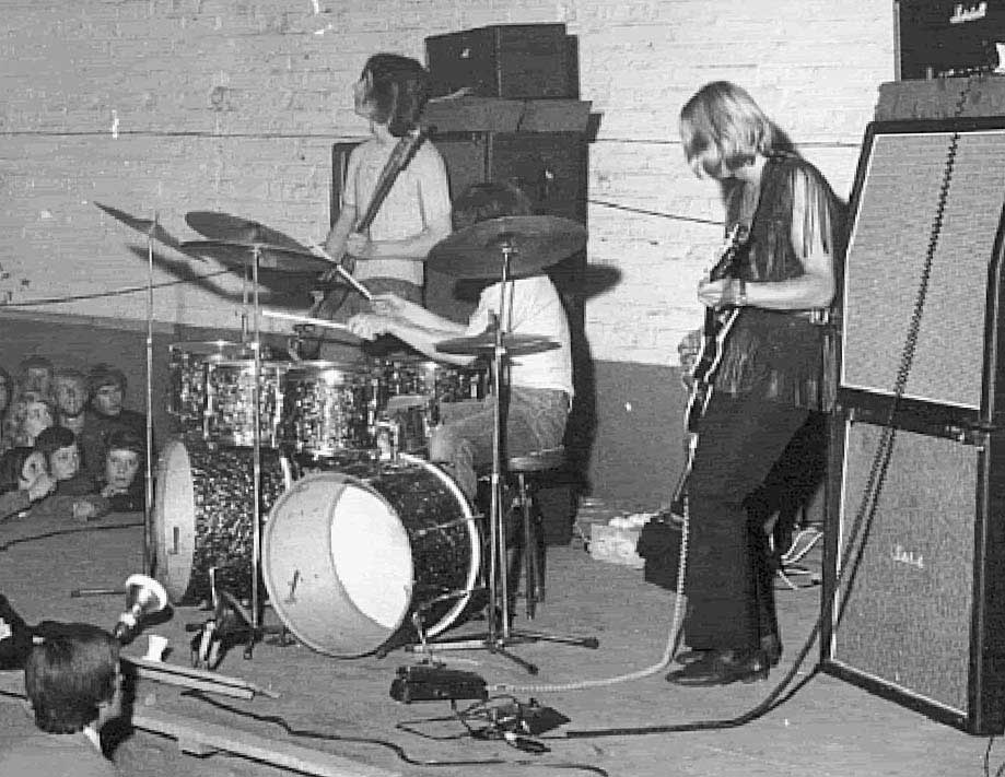 Mick Ronson with the Rats. A wha and the Tone Bender MKI can be seen.
